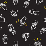 Seamless pattern with hands showing different signs Royalty Free Stock Images