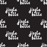 Seamless pattern with Handwritten calligraphy - Jingle bells. Hand drawn lettering Christmas and New Year holiday phrase. Background for poster, cards Stock Photos
