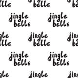 Seamless pattern with Handwritten calligraphy - Jingle bells. Hand drawn lettering Christmas and New Year holiday phrase. Background for poster, cards Royalty Free Stock Images
