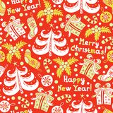 Seamless pattern Happy New Year and Christmas. On a red background Royalty Free Stock Photos
