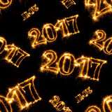 Seamless pattern of Happy New Year - 2017 with sparklers. On black background Stock Photography