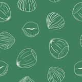 Seamless pattern with hazelnuts. Hand drawn vector. Royalty Free Stock Images