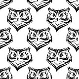 Seamless pattern of the head of a fierce owl Royalty Free Stock Photography