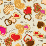 Seamless pattern of heart cookies Stock Photos