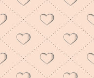 Seamless pattern with heart in vintage style engraving on a beige background for Valentine's Day. Hand drawn Royalty Free Stock Image