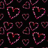 Seamless pattern with hearts on a black background. NnFor printing on fabric, paper, cardboard and other purposes Royalty Free Stock Photos