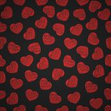Seamless pattern from hearts on a black background. Valentine`s Day. Painted scrawl. Background for your design. Vector. Seamless pattern from hearts on a black Royalty Free Stock Images