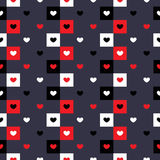 Seamless pattern of hearts on a blue background. On a blue background pattern of hearts in different colors vector illustration