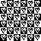 Seamless pattern hearts in cells Royalty Free Stock Photography
