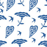 Seamless pattern with hearts flowers and swallows Stock Image
