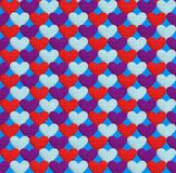 Seamless pattern with hearts. Texture in the form of a fabric. Seamless pattern with hearts. Hearts of three different colors on a blue background. Texture in Stock Photos