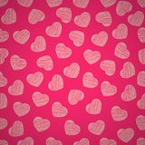 Seamless pattern from hearts on a pink background. Valentine`s Day. Painted scrawl. Background for your design. Vector. Seamless pattern from hearts on a pink Royalty Free Stock Photos