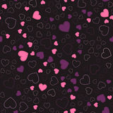Seamless pattern with hearts. pink hearts. romantic pattern. Pink and purple hearts on a black background Stock Image