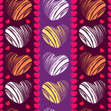 Seamless pattern with hearts on the striped background Stock Image