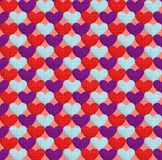 Seamless pattern with hearts. Texture in the form of a fabric. Seamless pattern with hearts. Hearts of three different colors on a background of coral color Stock Photo