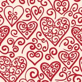 Seamless pattern with hearts. Vector seamless pattern hand drawn, doodle hearts in red, swirl design elements Stock Images