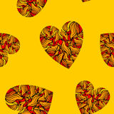 Seamless pattern with hearts on yellow background. Stock Photo