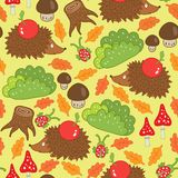 Seamless pattern hedgehog in a forest clearing Royalty Free Stock Photos
