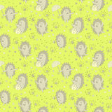 Seamless pattern with hedgehogs and dandelion flowers Royalty Free Stock Photography