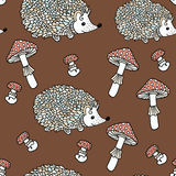 Seamless pattern with hedgehogs and mushrooms. Royalty Free Stock Photo