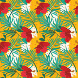 Seamless pattern with hibiscus flowers and palm leaves Royalty Free Stock Photography
