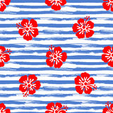 Seamless pattern with hibiscus flowers on striped background. Tropical summer illustration. Vector Stock Photo