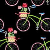 Seamless pattern with hipster bikes. Vector seamless pattern with hipster bikes, wicker baskets, flowers, geraniums, ribbons on a black background. Vintage Stock Images