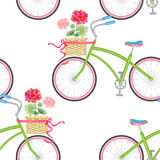 Seamless pattern with hipster bikes. Vector seamless pattern with hipster bikes, wicker baskets, flowers, geraniums, ribbons on a white background. Vintage Royalty Free Stock Image