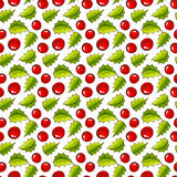 Seamless pattern with holly. Christmas background. Royalty Free Stock Images