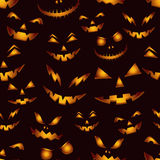 Seamless pattern with horror faces. Halloween background. Stock Photos
