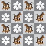 Seamless pattern with horses and flowers in squares. Royalty Free Stock Images