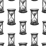 Seamless pattern of hourglasses sketches royalty free illustration