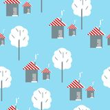 Seamless pattern. Houses on a blue background. Seamless pattern. White houses on a blue background royalty free illustration