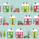 Seamless pattern with houses and cars in winter time Royalty Free Stock Image