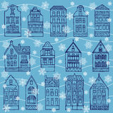 Seamless pattern with houses and flakes of snow Stock Photography