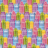 Seamless pattern with houses. Tile little town pastel background. Wrapping paper texture with multicolor buildings.  Royalty Free Stock Photos