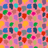 Seamless pattern from human faces. Royalty Free Stock Photo