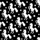 Seamless pattern illustration with white stars and unicorns on black background. Seamless vector pattern illustration with white stars and unicorns on black Royalty Free Stock Photo