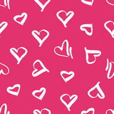 Seamless pattern with the image of hearts. Stock Photos