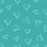 Seamless pattern with the image of hearts. Stock Photography