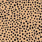 Seamless pattern. Imitation of skin of cheetah. Black and brown spots on brown background. Stock Photo