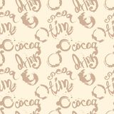 Seamless pattern with inscriptions about cocoa and stains from a cup in pastel brown colors. Stock Photography