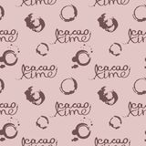 Seamless pattern with inscriptions about cocoa and stains from a cup in pastel brown colors. Royalty Free Stock Photography