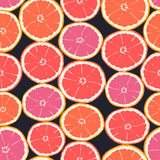 Seamless pattern of isolated hand drawn oranges slices on black Royalty Free Stock Photo