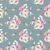 Seamless pattern with isolated watercolor floral bouquets from tender flowers and leaves in pink and purple pastel shades. Hand drawn on a gray-blue background Royalty Free Stock Image