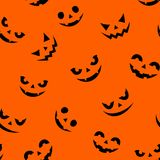 Seamless pattern with Jack-O-Lantern faces on orange. Vector illustration. Vector seamless pattern with Jack-O-Lantern faces on an orange background Stock Images