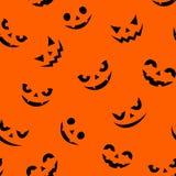 Seamless pattern with Jack-O-Lantern faces on orange. Vector illustration. Stock Images