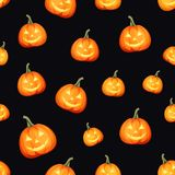 Seamless pattern with Jack-O-Lanterns Halloween pumpkins. Vector illustration. Vector seamless pattern with Jack-O-Lanterns Halloween pumpkins on a black Stock Photo