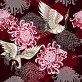 Seamless pattern with Japanese white cranes and chrysanthemums on a claret background for textile design Royalty Free Stock Photo