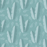 Seamless pattern with jungle palm leaves on blue background Stock Image